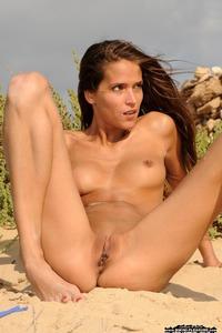 Silvie Deluxe Strips Off Her Sexy Micro Bikini 02