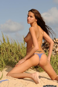 Silvie Deluxe Strips Off Her Sexy Micro Bikini 11