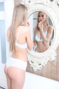 Slim Blonde Beauty Nancy Watches Herself In The Mirror 02