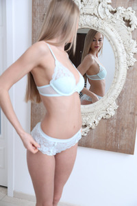Slim Blonde Beauty Nancy Watches Herself In The Mirror 05