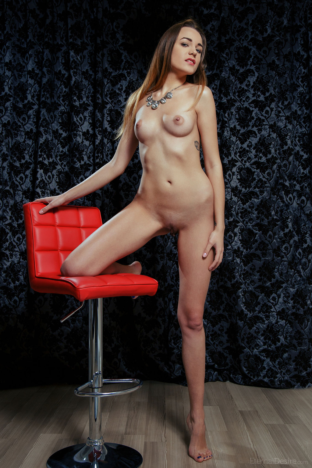 Sexy Evangelina Spreading On A Red Chair 02